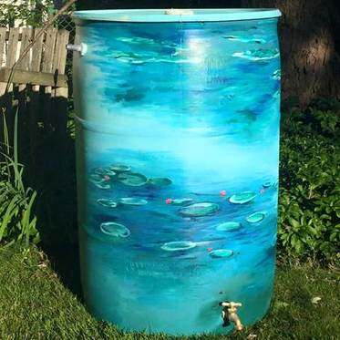Rain Barrel painted by Christy Koerner after she put it together at one of our workshops.
